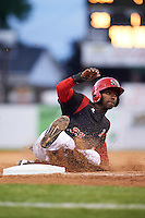 Batavia Muckdogs first baseman Javier Lopez (23) slides into third base during a game against the West Virginia Black Bears on June 28, 2016 at Dwyer Stadium in Batavia, New York.  Batavia defeated West Virginia 3-1.  (Mike Janes/Four Seam Images)
