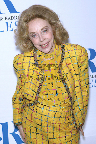 DR. JOYCE BROTHERS.Launch party for the second year of MTR?s She Made It: Women Creating Television and Radio - Arrivals held at the Museum of Television & Radio, Beverly Hills, California, USA..December 5th, 2006.half length yellow tweed skirt jacket.CAP/ADM/ZL.©Zach Lipp/AdMedia/Capital Pictures