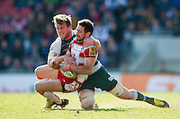 Greig Laidlaw of Gloucester Rugby is tackled by Brendon O'Connor of Leicester Tigers. Aviva Premiership match, between Leicester Tigers and Gloucester Rugby on April 2, 2016 at Welford Road in Leicester, England. Photo by: Patrick Khachfe / JMP