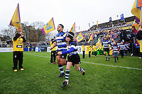 Ben Tapuai of Bath Rugby, mascot in hand, runs out onto the field. Aviva Premiership match, between Bath Rugby and Saracens on December 3, 2016 at the Recreation Ground in Bath, England. Photo by: Patrick Khachfe / Onside Images