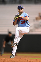 Cedar Rapids Kernels pitcher Jake Reed (36) delivers a pitch during a game against the Quad Cities River Bandits on August 19, 2014 at Perfect Game Field at Veterans Memorial Stadium in Cedar Rapids, Iowa.  Cedar Rapids defeated Quad Cities 5-3.  (Mike Janes/Four Seam Images)