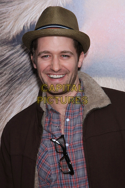 "MATTHEW MORRISON .Attending the New York Premiere of ""Where The Wild Things Are"" held at Alice Tully Hall - Lincoln Center, New York, NY, USA, October 13th, 2009..portrait headshot smiling beard facial hair glasses brown jacket hat red plaid shirt checked check .CAP/LNC/TOM.©LNC/Capital Pictures."