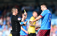 Scunthorpe United's Murray Wallace is shown a yellow card by referee David Webb <br /> <br /> Photographer Chris Vaughan/CameraSport<br /> <br /> The EFL Sky Bet League One - Scunthorpe United v Bolton Wanderers - Saturday 8th April 2017 - Glanford Park - Scunthorpe<br /> <br /> World Copyright &copy; 2017 CameraSport. All rights reserved. 43 Linden Ave. Countesthorpe. Leicester. England. LE8 5PG - Tel: +44 (0) 116 277 4147 - admin@camerasport.com - www.camerasport.com