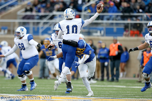 BROOKINGS, SD, OCTOBER 6: Austin Smenda #34 from South Dakota State University hits quarterback Ryan Boyle #10 from Indiana State as he passes the ball during their game Saturday night at Dana J. Dykhouse Stadium in Brookings. (Dave Eggen/Inertia)
