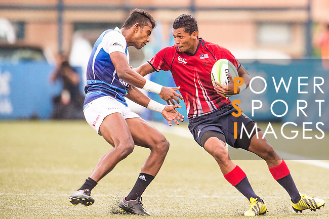 Mohd Khairul Amrie Jafree (r) of Malaysia battles for the ball during the match between Sri Lanka and Malaysia of the Asia Rugby U20 Sevens Series 2016 on 12 August 2016 at the King's Park, in Hong Kong, China. Photo by Marcio Machado / Power Sport Images