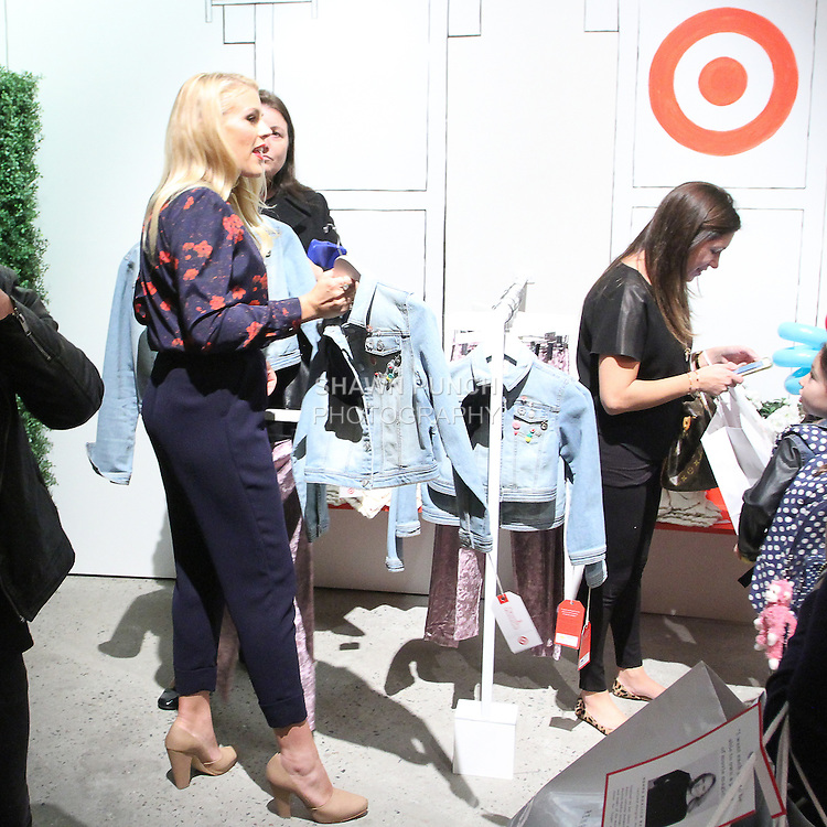 Busy Philipps shops at the Annie For Target collection celebration and pop-up shop at Stage 37 in New York City on November 4, 2014.
