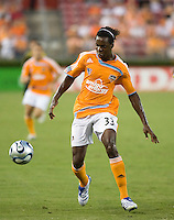 Houston Dynamo forward Joseph Ngwenya (33) dribbles the ball. The Houston Dynamo tied the Columbus Crew 1-1 in a regular season MLS match at Robertson Stadium in Houston, TX on August 25, 2007.