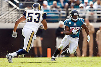 October 18, 2009:      Jacksonville Jaguars running back Maurice Jones-Drew (32) tries to elude the tackle of St. Louis Rams linebacker Paris Lenon (53) during action between the NFC West St. Louis Rams and AFC South Jacksonville Jaguars at Jacksonville Municipal Stadium in Jacksonville, Florida. Jacksonville defeated St. Louis in overtime 23-20............