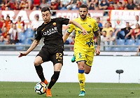 Roma s Stephan El Shaarawy, left, prepares to kick to score as he is chased by Chievo Verona s Alessandro Gamberini during the Italian Serie A football match between Roma and Chievo Verona at Rome's Olympic stadium, 28 April 2018.<br /> UPDATE IMAGES PRESS/Riccardo De Luca