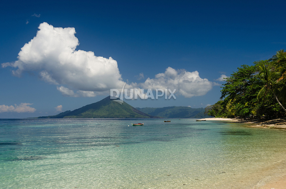 From Ai Island, the view of Gunung Api and Banda Besar cuts a classic view of this remote Indonesian archipelago.