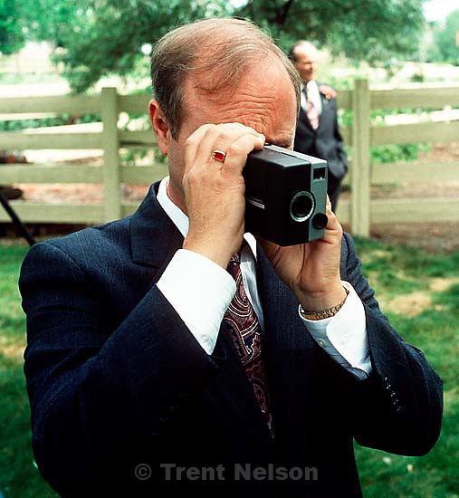 Steve Nelson with home movie camera at Trent and Laura Nelson's wedding.  &amp;#xA;<br />
