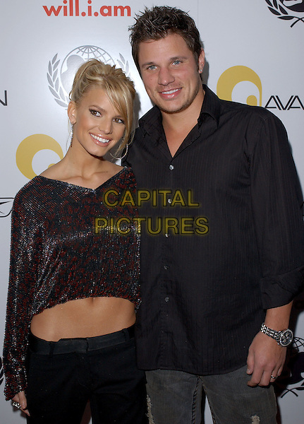 JESSICA SIMPSON & NICK LACHEY.Will.i.am Music Group and RBK's Tsunami Relief Benefit Concert held at Avalon in Hollywood, California .February 11th, 2005.half length celebrity couple married husband wife black shirt cropped belly stomach midriff shiny shimmery.www.capitalpictures.com.sales@capitalpictures.com.Supplied By Capital PIctures