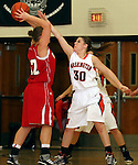 SIOUX FALLS, SD: DECEMBER 20: Kelsey Knecht #30 from Washington applies pressure to Morgan Tessier #32 from Yankton in the the first half of their game Friday night at Washington. (photo by Dave Eggen/Inertia)