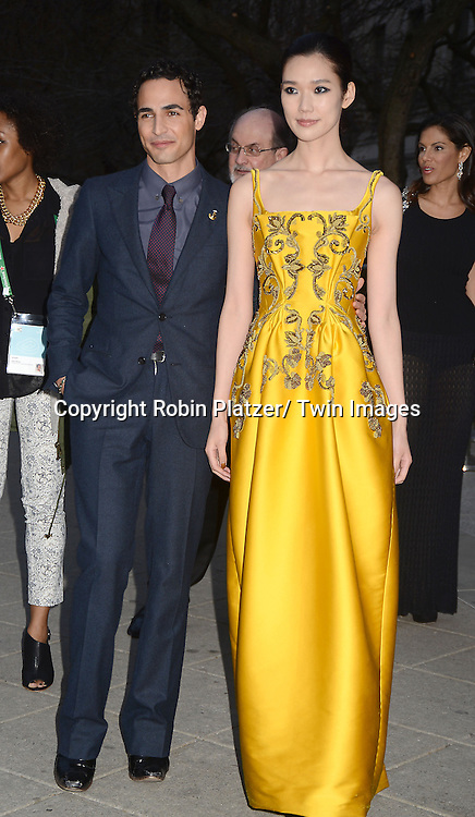 Zac Posen and Tao Okamoto attends the Vanity Fair Party for the 2013 Tribeca Film Festival on April 16, 2013 at State Suprme Courthouse in New York City.