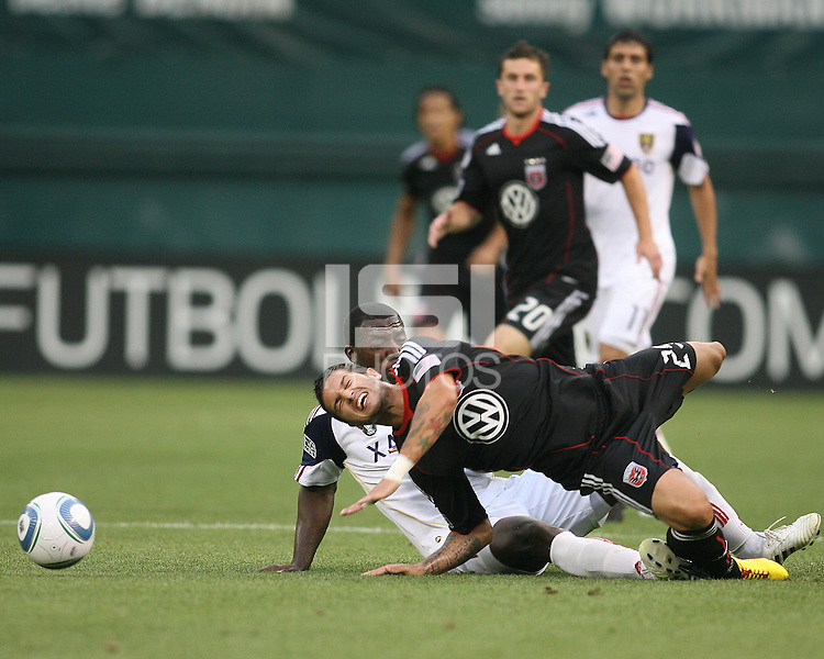 Santino Quaranta #25 of D.C. United rashes to the ground after a takle from Jean Alexandre #12 of Real Salt Lake during an MLS match at RFK Stadium, on June 5 2010 in Washington DC. The game ended in a 0-0 tie.