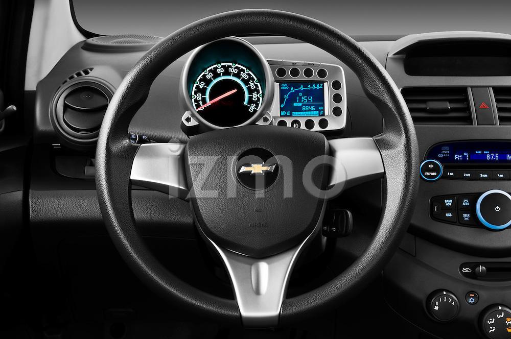 Steering wheel view of a 2011 Chevrolet Spark LS 5 Door Hatchback
