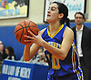 Clare Calabro #10 of Kellenberg squares to the hoop during the first half of a CHSAA varsity girls basketball game against host Our Lady of Mercy Academy on Friday, Jan. 13, 2017. She drained a long-range three-pointer at the end of the fourth quarter to lift the Lady Firebirds to a dramatic 48-47 win.