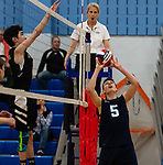 OXFORD,  CT-041519JS18- Oxford's Colin Speaker (5) sets the ball at the net in front of Joel Barlow's Rhys Robichaud (8) during their match Monday at Oxford High School. <br /> Jim Shannon Republican American