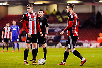 Sheffield United's midfielder John Lundstram (7) and Sheffield United's midfielder Lee Evans (20) over a free kick during the Sky Bet Championship match between Sheff United and Cardiff City at Bramall Lane, Sheffield, England on 2 April 2018. Photo by Stephen Buckley / PRiME Media Images.