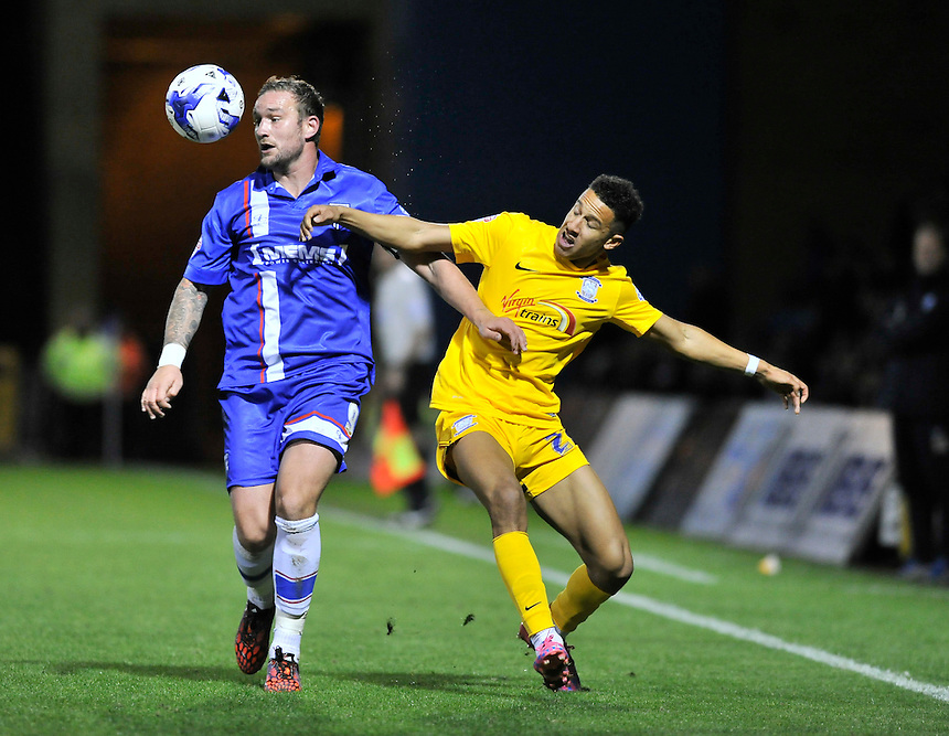 Gillingham's Danny Kedwell holds off the challenge from   Callum Robinson<br /> <br /> Photographer Ashley Western/CameraSport<br /> <br /> Football - The Football League Sky Bet League One - Gillingham v Preston North End - Tuesday 21st October 2014 - MEMS Priestfield Stadium - Gillingham<br /> <br /> &copy; CameraSport - 43 Linden Ave. Countesthorpe. Leicester. England. LE8 5PG - Tel: +44 (0) 116 277 4147 - admin@camerasport.com - www.camerasport.com