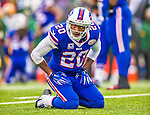 14 December 2014: Buffalo Bills cornerback Corey Graham shows emotion on his knees after a play in the second quarter against the Green Bay Packers at Ralph Wilson Stadium in Orchard Park, NY. The Bills defeated the Packers 21-13, snapping the Packers' 5-game winning streak and keeping the Bills' 2014 playoff hopes alive. Mandatory Credit: Ed Wolfstein Photo *** RAW (NEF) Image File Available ***