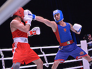 Fairfax, VA - July 1, 2015: Dario Vangeli of the Italy State Police (blue) delivers a punch to the face of Amir Shamkhalov of the Russian Police (red) in a boxing match during the World Police and Fire Games at the George Mason University in Fairfax, Virginia, July 1, 2015.   (Photo by Don Baxter/Media Images International)