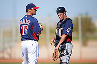 Cleveland Indians minor league manager Dave Wallace #17 talks with catcher Richard Stock #2 while making a pitching change during an instructional league game against the Cincinnati Reds at the Goodyear Training Complex on October 8, 2012 in Goodyear, Arizona.  (Mike Janes/Four Seam Images)
