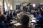 United States President George W. Bush holds a Cabinet meeting at the White House in Washington, DC on April 9, 2001.  During the meeting he made another statement on the China situation. Pictured from lower left around the table going to the right: US Secretary of Education Rod Paige; US Secretary of Health and Human Services Tommy Thompson; US Secretary of Interior Gale Norton; US Secretary of State Colin Powell; President Bush; US Secretary of Defense Donald Rumsfeld; US Secretary of Commerce Don Evans; US Secretary of Transportation Norman Mineta; OMB Director Mitch Daniels; White House Chief of Staff Andy Card; US Trade Representative Robert Zoellick; US Secretary of Housing and Urban Development Mel Martinez; US Secretary of Agriculture Ann Veneman; US Secretary of Treasury Paul O'Neill; US Vice President Dick Cheney; US Attorney General John Ashcroft; US Secretary of Labor Elaine Chao; US Secretary of Energy Spencer Abraham; and Administrator of Environmental Protection Agency Christine Todd Whitman.  White House Press Secretary Ari Fleischer is also visible in the upper center background in front of the Eisenhower portrait.<br /> Credit: Jamal A. Wilson - Pool via CNP