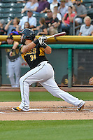 Juan Graterol (34) of the Salt Lake Bees follows through on his swing against the Albuquerque Isotopes during the Pacific Coast League game at Smith's Ballpark on August 30, 2016 in Salt Lake City, Utah. The Bees defeated the Isotopes 3-2. (Stephen Smith/Four Seam Images)