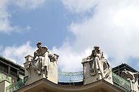 2 white sculptures on the top of a building in prague in the old town.<br /> <br /> Editorial use only.