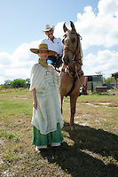 Chef Patricia Quintana and Hector at Lol-Ha ranch where organic hairless pigs (puerco pelón) are raised. Yucatan, Mexico