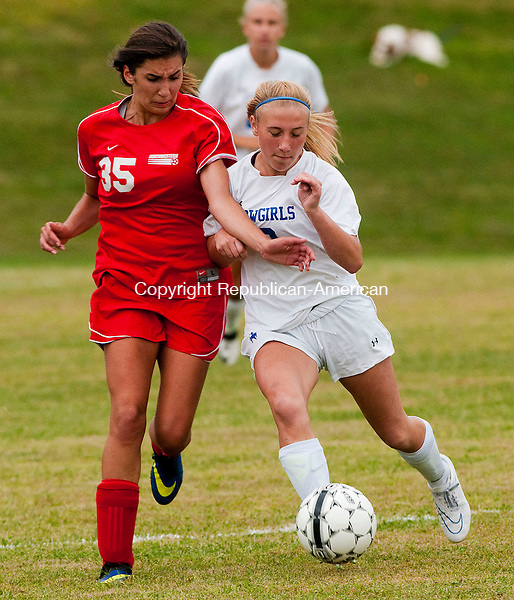 LITCHFIELD CT- 09 SEPTEMBER 2014-090914JS07--Northwestern's Kaitlyn Solak (35) and Litchfield's Ashley Ray (3) battle for the ball during their season opening game Tuesday at the Plum Hill Field Complex in Litchfield.<br /> Jim Shannon Republican-American