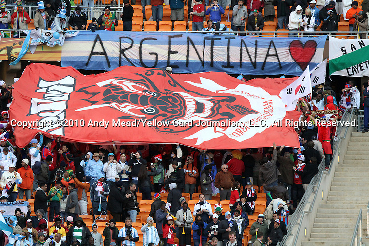 17 JUN 2010:  Argentina and South Korea banners in the stands.  The Argentina National Team defeated the South Korea National Team 4-1 at Soccer City Stadium in Johannesburg, South Africa in a 2010 FIFA World Cup Group E match.