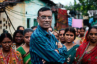 Mr. Chandrashekhar Ghosh, 52,  founder and CMD of  Bandhan Micro finance, surrounded by a group of beneficiaries at Daspara slum, Kolkata, West Bengal, India. Arindam Mukherjee