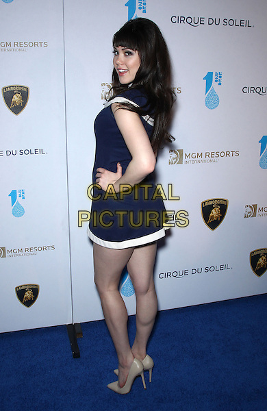 Claire Sinclair.Attending One Night for One Drop Charity Event at Hyde nightclub inside The Bellagio Resort and Casino, Las Vegas, NV, USA, 22nd March 2013..full length hand on hip navy blue white smiling back rear behind over shoulder dress trim .CAP/ADM/MJT.© MJT/AdMedia/Capital Pictures.