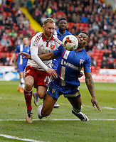 Sheffield United v Gillingham .Sky Bet League 1 ....... Uniteds Matt Done with Gilliunghams Deji Oshilaja