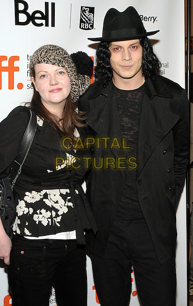 MEG WHITE & JACK WHITE.The 'The White Stripes: Under Great White Northern Lights' screening held at Elign Theatre during the 2009 Toronto International Film Festival, Toronto, Ontario, Canada. .September 18th, 2009 .half length black top hat suit white brown .CAP/ADM/BPC.©Brent Perniac/AdMedia/Capital Pictures.