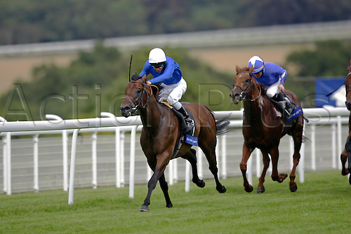 27 July 2004: Jockey KERRIN McEVOY (white cap) rides BYRON to victory in the Betfair Cup at Goodwood Photo: Glyn Kirk/Action Plus...horse racing 040727 flat lennox stakes