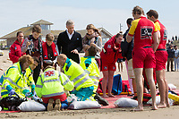 Le roi Philippe de Belgique, la reine Mathilde de Belgique, leurs enfants ; la Princesse Elisabeth, le Prince Gabriel, le Prince Emmanuel et la Princesse El&eacute;onore assistent &agrave; une d&eacute;monstration des services de sauvetage sur la plage de Middelkerke. <br /> La princesse Elisabeth a elle-m&ecirc;me particip&eacute; &agrave; la r&eacute;animation.<br /> Belgique, Middelkerke, 1er juillet 2017.<br /> King Philippe of Belgium, Queen Mathilde of Belgium and their children, Crown Princess Elisabeth, Prince Emmanuel, Prince Gabriel, and Princess Eleonore of Belgium pictured during a rescue exercice, part of a visit of Belgian royal couple at the Belgian coast, in Westende, Middelkerke.<br />  Belgium, Westende, Middelkerke, 01 July 2017.<br /> Pic :  King Philippe of Belgium &amp; Prince Gabriel of Belgium, Crown Princess Elisabeth of Belgium, Prince Emmanuel of Belgium