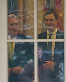 United States House Minority Leader Kevin McCarthy (Republican of California) and Senior Advisor Jared Kushner are seen through the Oval Office window prior to US President Donald J. Trump makes a statement following his meeting with Democratic leaders in the Situation Room of the White House in Washington, DC in an effort to break the political impasse on border security and reopen the federal government on Friday, January 4, 2018.  The President also took questions from reporters.<br /> Credit: Ron Sachs / CNP