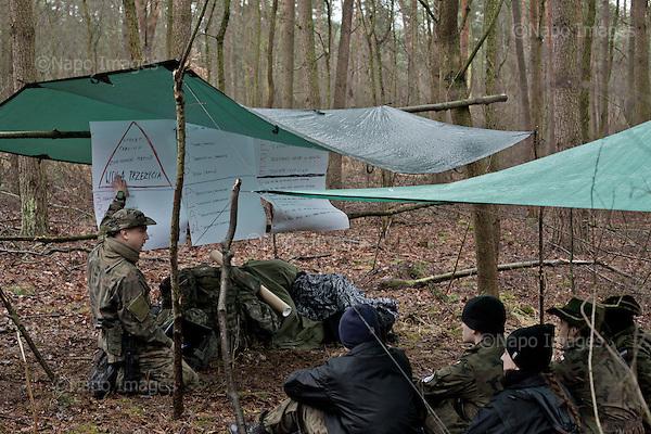OKOLICE KONINA, 3/2015:<br /> Czlonkowie organizacji &quot;Strzelec&quot; podczas obozu szkoleniowego w lesie. Od rozpoczecia wojny na Ukrainie rozne organizacje paramilitarne staja sie coraz bardziej popularne.<br /> Fot: Piotr Malecki<br /> <br /> FOREST NEAR KONIN, POLAND, MARCH 2015:<br /> Tomasz, left, instructor and member of &quot;Strzelec&quot; (&quot;The Shooter&quot;) paramilitary association during survival training to young cadets in the forest. <br /> Since the start of war in Ukraine, paramilitary associations are becoming more popular.<br /> (Photo by Piotr Malecki)
