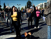 Athens 28.10.2011 Greece<br /> Protests during National Holiday &quot;Ohi Day&quot; in Athens in the Financial District.<br /> For many years Greek governments increased spending despite unability to settle the public debt reaching now the amount of 300 billion euros. But that is not the sole problem. The Greek economy crises is also due to the corruption that pervades every corner of day to day life in the country. Transparency International proves that bribery, patronage and other public corruption costs .Greece 8% of its GDP annually, placing the counrty among top of the list of countries drowning in systemic corruption.<br /> Photo: Adam Lach / Napo Images<br /> <br /> Protesty podczas swieta narodowego w grecji &quot;Ohi Day&quot; w dzielnicy finansowej w Atenach.<br /> Przez wiele lat greckie rzady zwiekszaly wydatki bez pokrycia, wynikiem tego jest skumulowanie dlugu publicznego do potwornych rozmiarow - ok 300 mld euro. Lecz to nie jedyny problem. Przyczyna greckiego kryzysu jest r&oacute;wnie? korupcja systemowa. Jak dowodzi Organizacja Transparncy International, rocznie, greckie gospodarstwa domowe wydaja na lapowki prawie 800 mln euro. To plasuje Ateny na czele listy krajow pograzonych w systemowej korupcji.<br /> Fot: Adam Lach / Napo Images