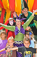 The Renaissance Fair is held each September at the historic museum of El Rancho de Las Golondrinas near Santa Fe and features dancers, knights, acrobats and many other performers celebrating the culture and lifestyle of the Medieval Middle Ages.  Clan Tynker is a family troup that performs acrobatics, magic tricks and other feats that keep the crowd entertained. Member of Clan Tynker poses with some young fans.