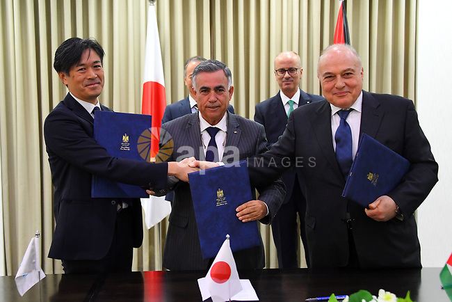Palestinian Prime Minister Rami Hamdallah attends a signing ceremony with ambassador of Japan to Palestine, Takeshi kubo, in the West Bank city of Ramallah, February 13, 2019. Photo by Prime Minister Office