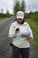 June 6, 2012 Lacy Karpilo recording a photo station location with a GPS, Denali National Park and Preserve, Alaska. Photo by Ron Karpilo.
