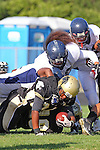 Palos Verdes CA 10/22/10 - Okuoma Idah (Peninsula #24) and Maafu Lavatai (C) (Leuzinger #56/58) in action during the Leuzinger - Peninsula varsity football game at Palos Verdes Peninsula High School.