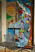 Mural showing a couple eating ice cream at an outdoor cafe, Bellingham, Washington, USA...