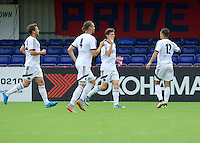 Matt McClure of Aldershot Town (middle) celebrates scoring his side's 2nd goal to make it 2-0 during the Friendly match between Aldershot Town and Wycombe Wanderers at the EBB Stadium, Aldershot, England on 26 July 2016. Photo by Alan  Stanford.
