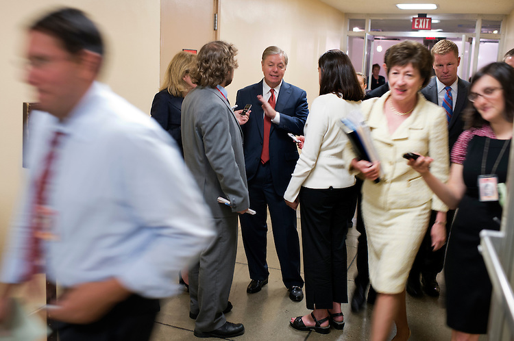UNITED STATES - JULY 31:  Sen. Lindsey Graham, R-S.C., talks with reporters in the basement of the Capitol before senate luncheons. (Photo By Tom Williams/CQ Roll Call)