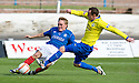 Morton's David OBrien goes in high on Cowdenbeath's Dean Brett   ...